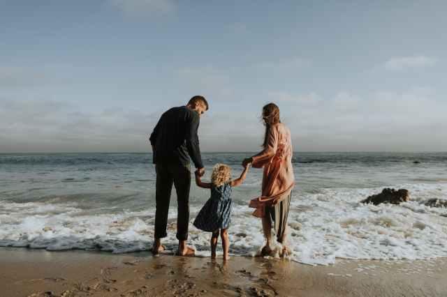 photo of family on seashore