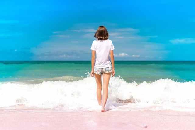 woman standing on seashore