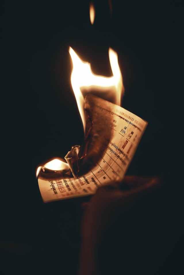 burning paper inside dark room