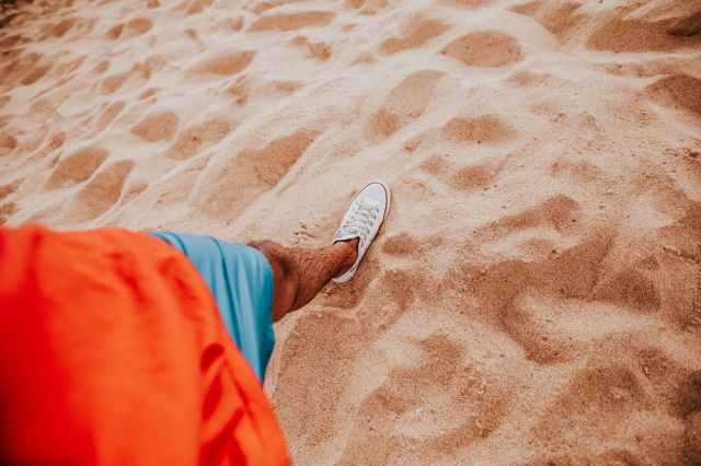 person wearing white shoe