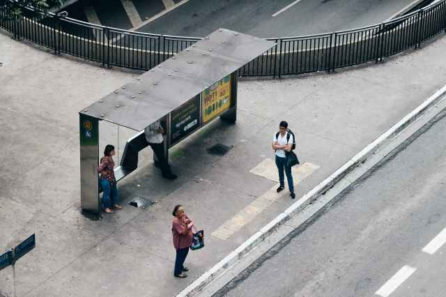 aerial photo of people on waiting shed