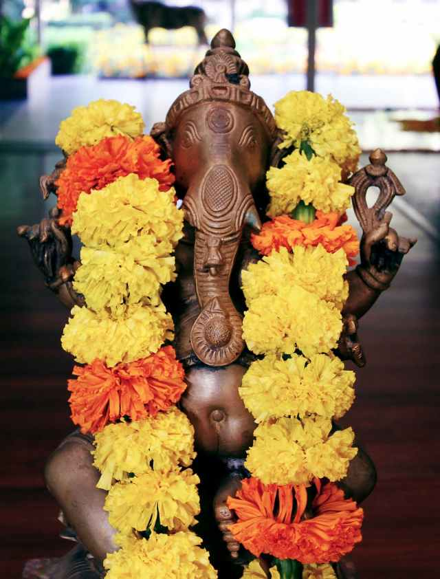 brown lord ganesha figurine