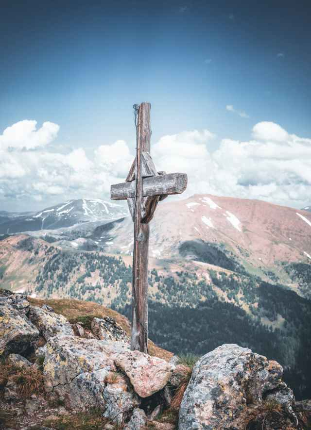 gray cross on mountain