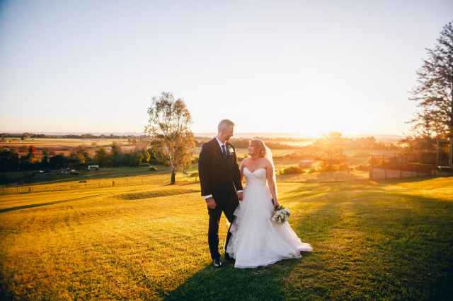 newly wed photo during sunset