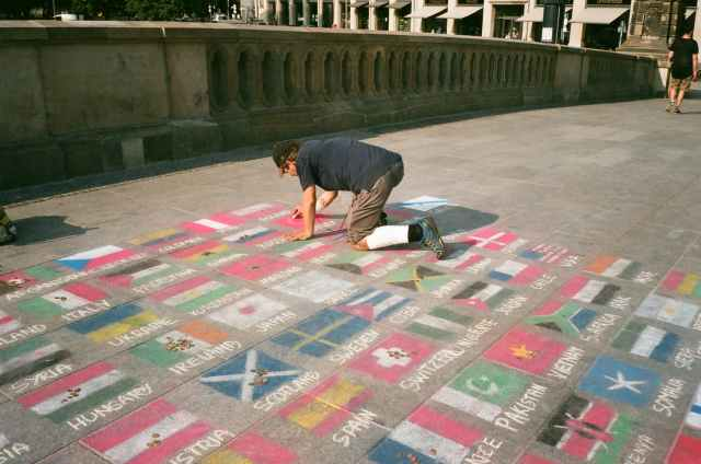 man drawing on floor