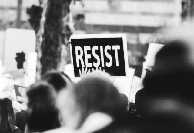 monochrome photo of resist signage