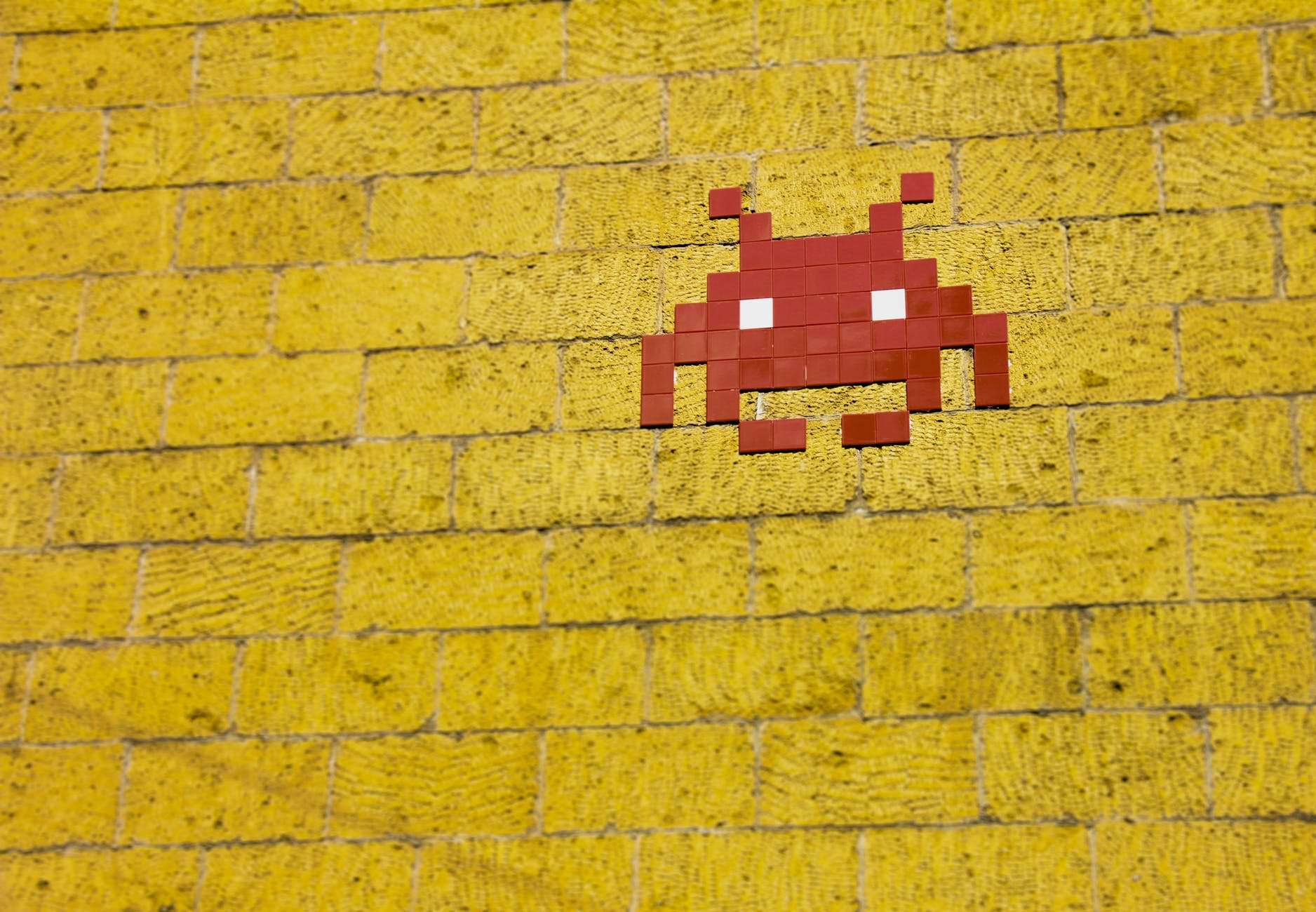 mosaic alien on wall
