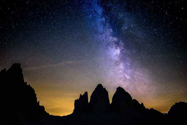 silhouette photography of rocky mountains under starry sky