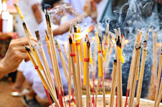close up photo of lighted incense sticks