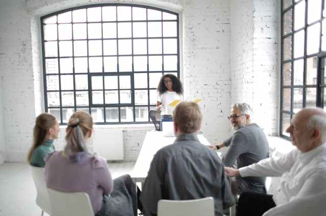 people having a team meeting
