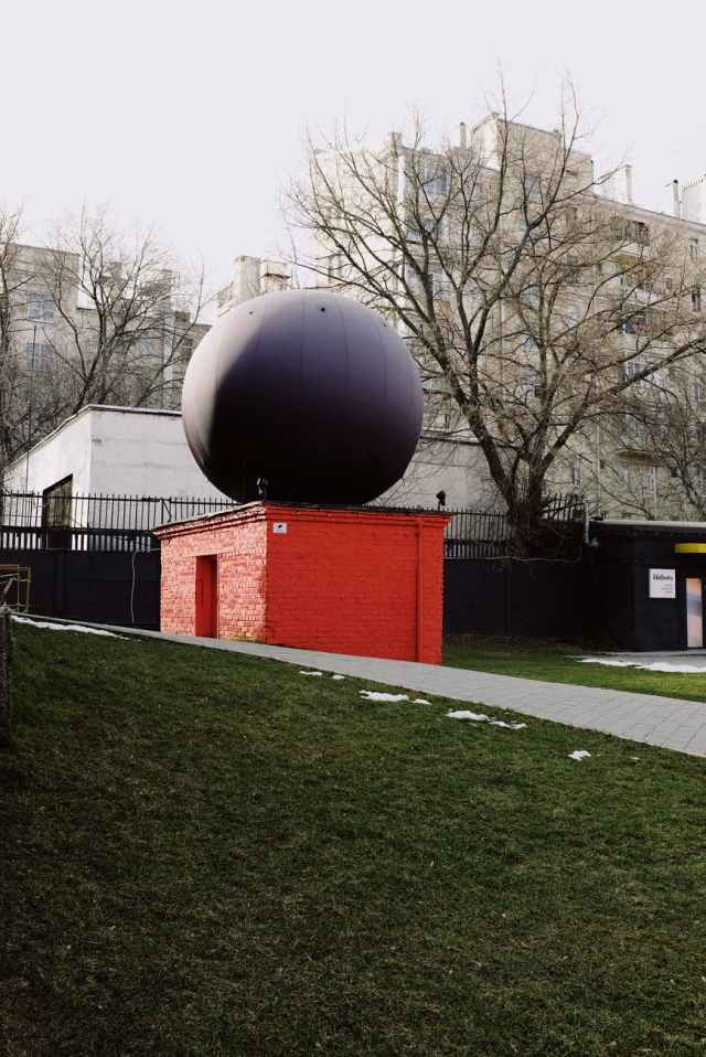 big ball radar on little modern building