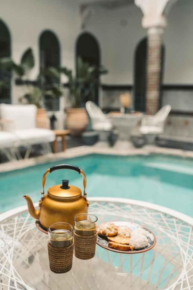 gold teapot on white round table