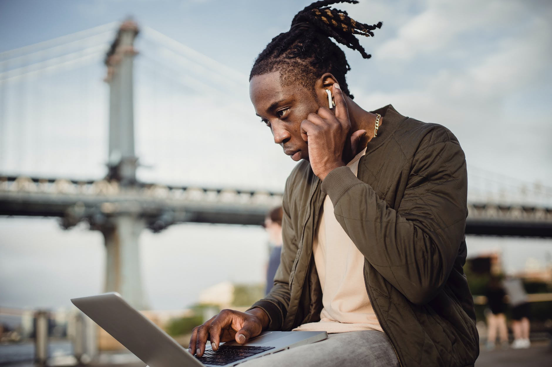 serious black man working on project on laptop